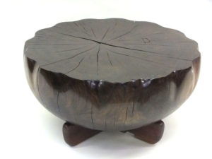 Round carved walnut coffee table.